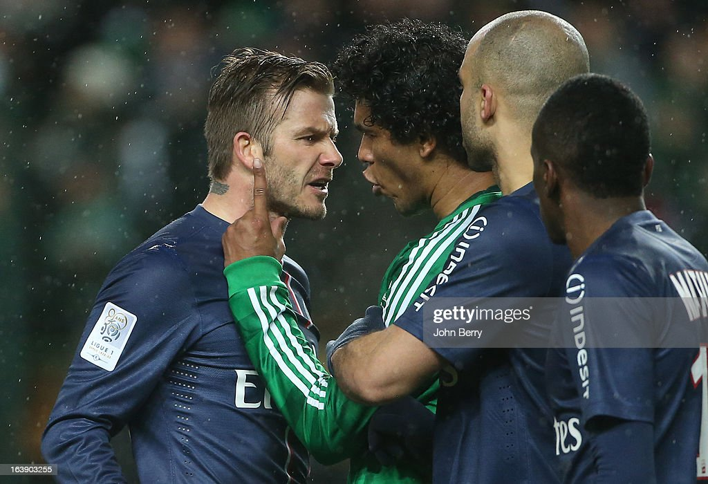 David Beckham of PSG argues with Brandao of Saint-Etienne at the end of the Ligue 1 match between AS Saint-Etienne ASSE and Paris Saint-Germain FC at the Stade Geoffroy-Guichard on March 17, 2013 in Saint-Etienne, France.