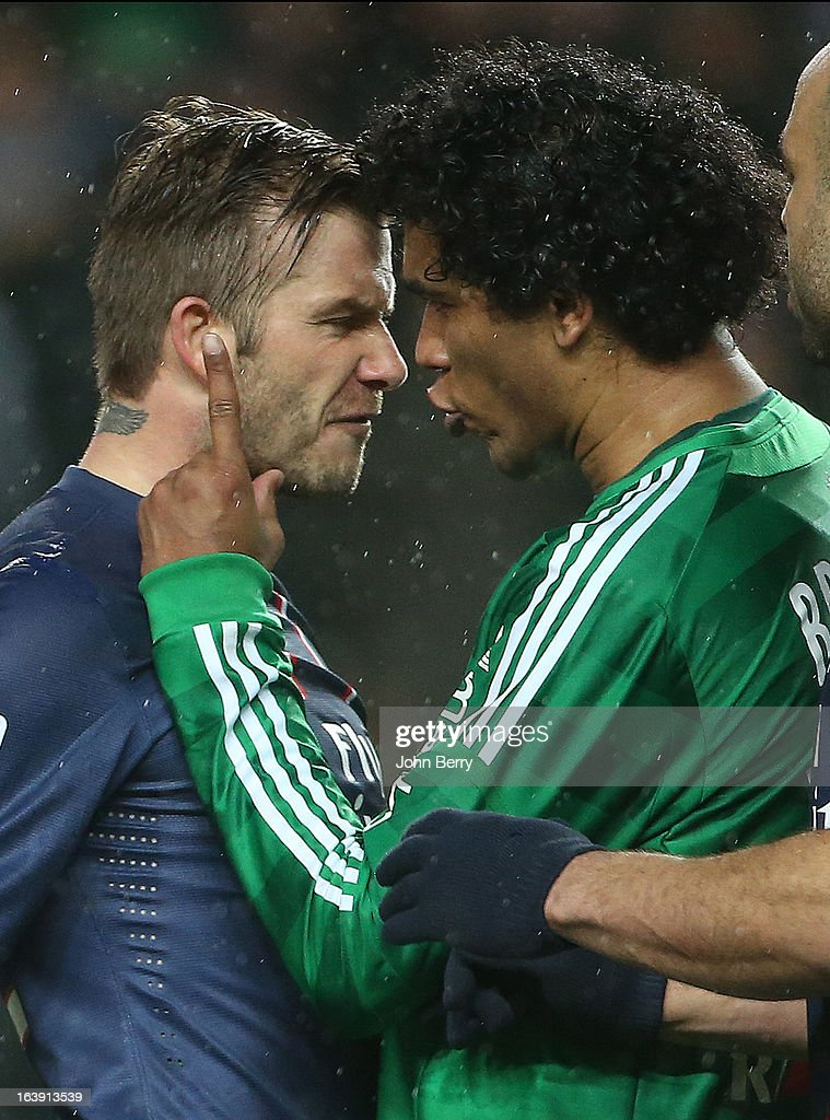 David Beckham of PSG argues with Brandao of Saint-Etienne during the Ligue 1 match between AS Saint-Etienne ASSE and Paris Saint-Germain FC at the Stade Geoffroy-Guichard on March 17, 2013 in Saint-Etienne, France.