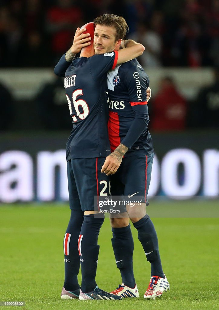 David Beckham of PSG gets emotional and cries when he leaves the field cheered by his teammates, Christophe Jallet during the Ligue 1 match between Paris Saint-Germain FC and Stade Brestois 29 at the Parc des Princes stadium on May 18, 2013 in Paris, France.