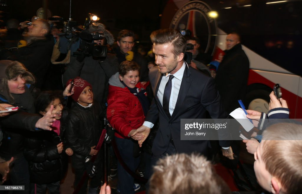 <a gi-track='captionPersonalityLinkClicked' href=/galleries/search?phrase=David+Beckham&family=editorial&specificpeople=158480 ng-click='$event.stopPropagation()'>David Beckham</a> of PSG greets fans as he arrives at the stadium ahead of the French Cup match between Paris Saint Germain FC and Olympique de Marseille OM at the Parc des Princes stadium on February 27, 2013 in Paris, France.