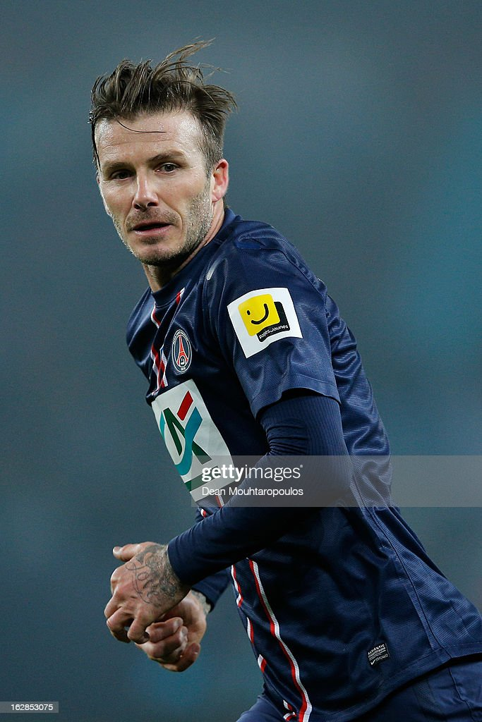 David Beckham of PSG in action during the French Cup match between Paris Saint-Germain FC and Marseille Olympic OM at Parc des Princes on February 27, 2013 in Paris, France.