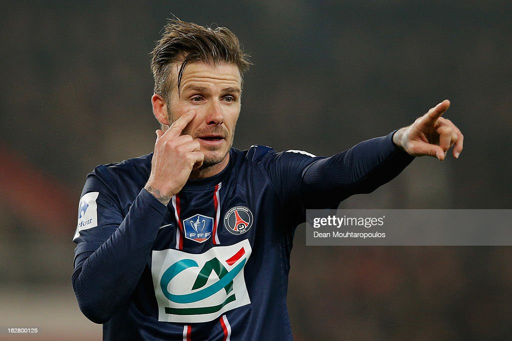 <a gi-track='captionPersonalityLinkClicked' href=/galleries/search?phrase=David+Beckham&family=editorial&specificpeople=158480 ng-click='$event.stopPropagation()'>David Beckham</a> of PSG signals to a team mate during the French Cup match between Paris Saint-Germain FC and Marseille Olympic OM at Parc des Princes on February 27, 2013 in Paris, France.