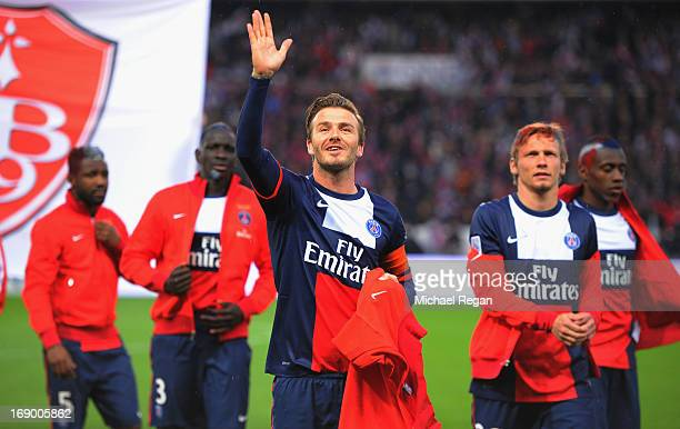 David Beckham of PSG waves to his family during the Ligue 1 match between Paris SaintGermain FC and Stade Brestois 29 at Parc des Princes on May 18...