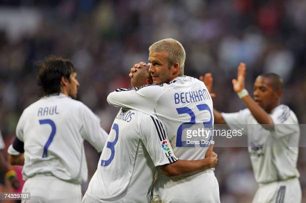 David Beckham of Real Madrid celebrates with Roberto Carlos after Real scored their 2nd goal during the Primera Liga match between Real Madrid and...