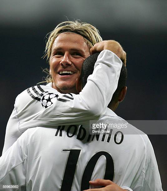 David Beckham of Real Madrid celebrates with Robinho after their team scored a goal during a UEFA Champions League group F match between Real Madrid...