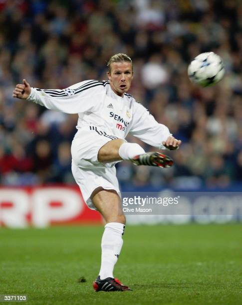 David Beckham of Real Madrid kicks the ball forward during the UEFA Champions League Quarter Final First Leg match between Real Madrid and Monaco...