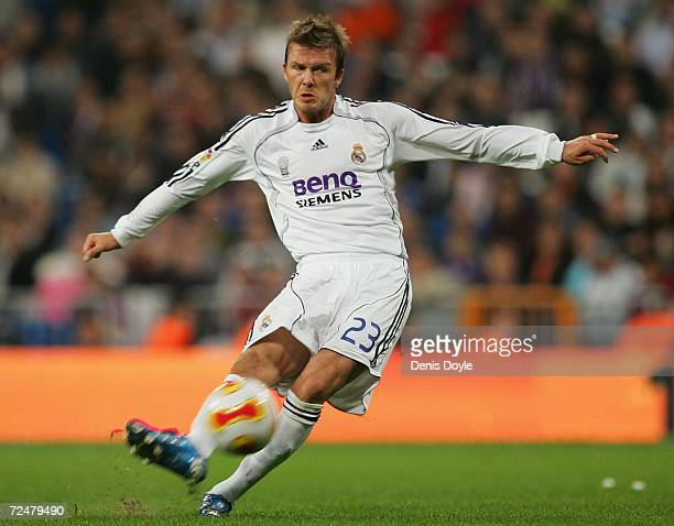 David Beckham of Real Madrid takes a free kick against Ecija during the Kings Cup fourth round second leg match between Real Madrid and Ecija at the...