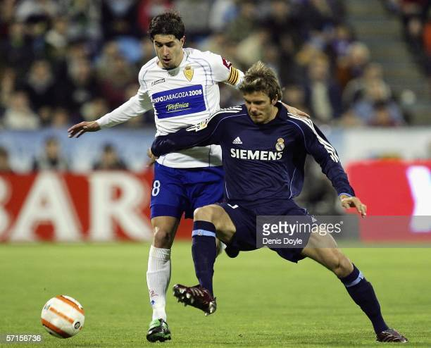 David Beckham of Real Madrid tries to hold off Cani of Real Zaragoza during a Primera Liga match between Real Zaragoza and Real Madrid at the...