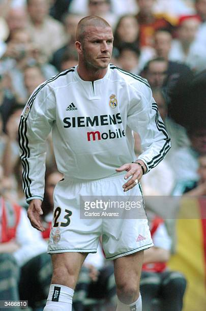 David Beckham of Real Madrid walks across the field during the football match against Barcelona at Santiago Bernabeu Stadium on April 25 2004 in...