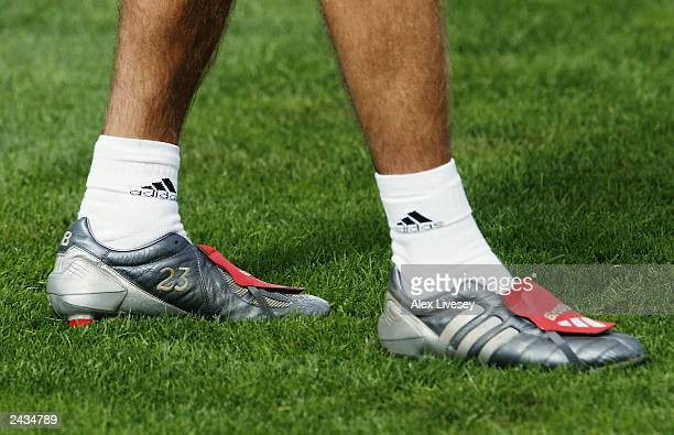 David Beckham of Real Madrid wears boots with his new squad number during a training session on July 27 2003 at the Hongta Sports Centre in Kunming...