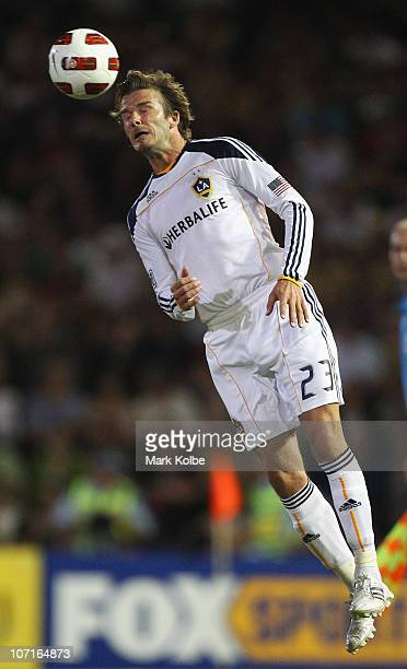 David Beckham of the Galaxy heads the ball during the friendly match between the Newcastle Jets and the LA Galaxy at EnergyAustralia Stadium on...