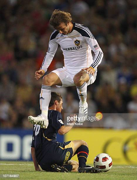 David Beckham of the Galaxy jumps over a Jets defender during the friendly match between the Newcastle Jets and the LA Galaxy at EnergyAustralia...