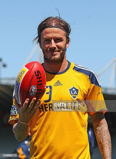 David Beckham of the Galaxy poses with an Australian Rules AFL football during an LA Galaxy training session at Visy Park on December 5 2011 in...