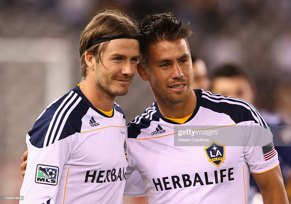 <a gi-track='captionPersonalityLinkClicked' href=/galleries/search?phrase=David+Beckham&family=editorial&specificpeople=158480 ng-click='$event.stopPropagation()'>David Beckham</a> of the LA Galaxy poses with <a gi-track='captionPersonalityLinkClicked' href=/galleries/search?phrase=Rodrigo+Vargas&family=editorial&specificpeople=793290 ng-click='$event.stopPropagation()'>Rodrigo Vargas</a> of the Victory after the friendly match between the Melbourne Victory and LA Galaxy at Etihad Stadium on December 6, 2011 in Melbourne, Australia.