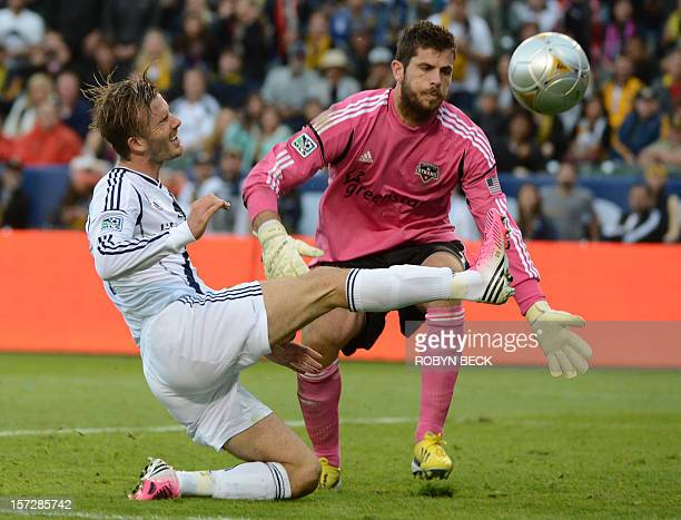 David Beckham of the Los Angeles Galaxy attacks the goal of Huston Dynamo's Tally Hall in the second half of the Major League Soccer Cup December 1...