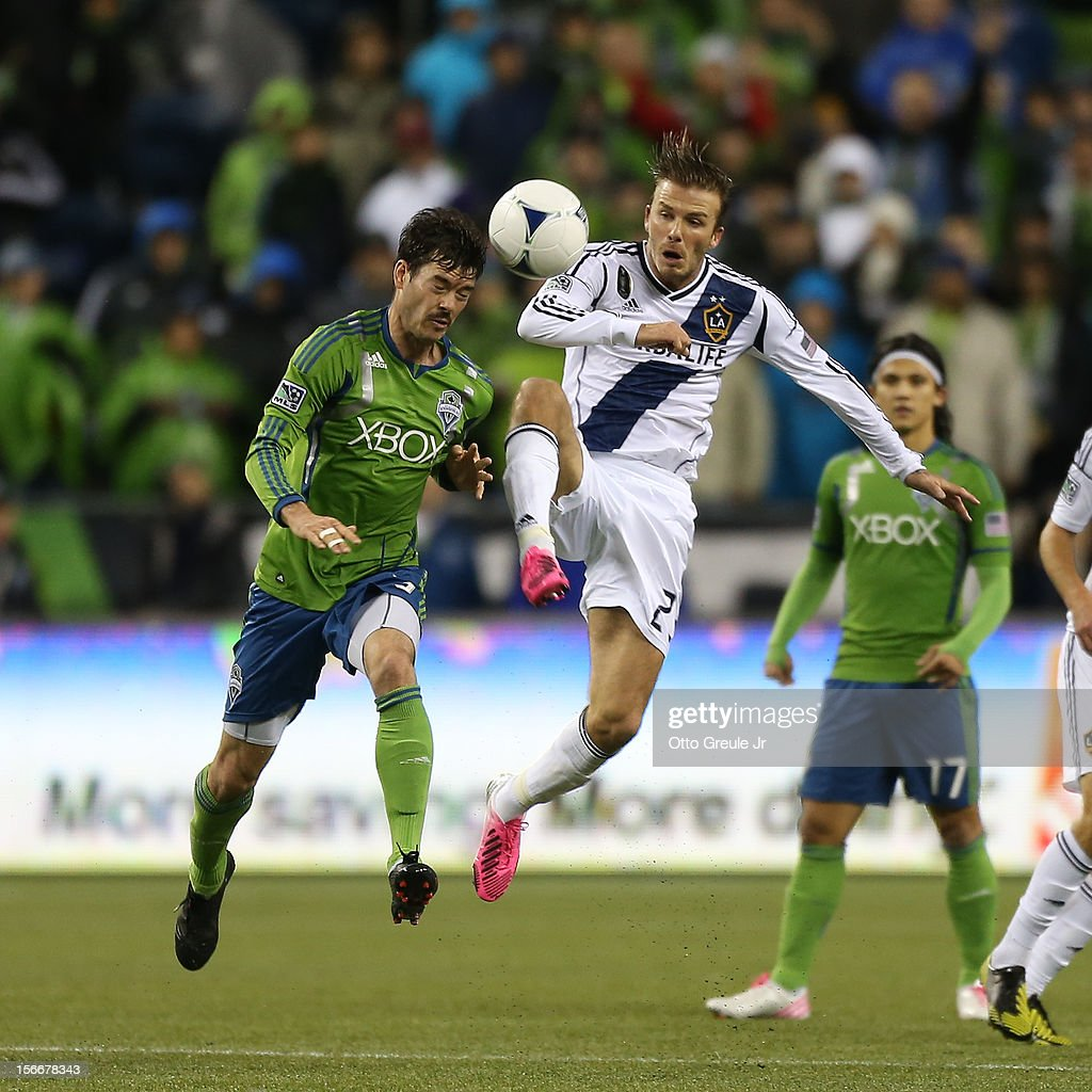 <a gi-track='captionPersonalityLinkClicked' href=/galleries/search?phrase=David+Beckham&family=editorial&specificpeople=158480 ng-click='$event.stopPropagation()'>David Beckham</a> #23 of the Los Angeles Galaxy battles Brad Evans #3 of the Seattle Sounders FC during Leg 2 of the Western Conference Championship at CenturyLink Field on November 18, 2012 in Seattle, Washington. The Galaxy defeated the Sounders 2-1, winning the aggregate playoff 4-2.