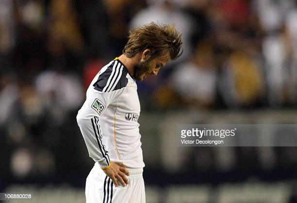 David Beckham of the Los Angeles Galaxy hangs his head after missing his mark on a pass in the second half during the Western Conference Finals match...