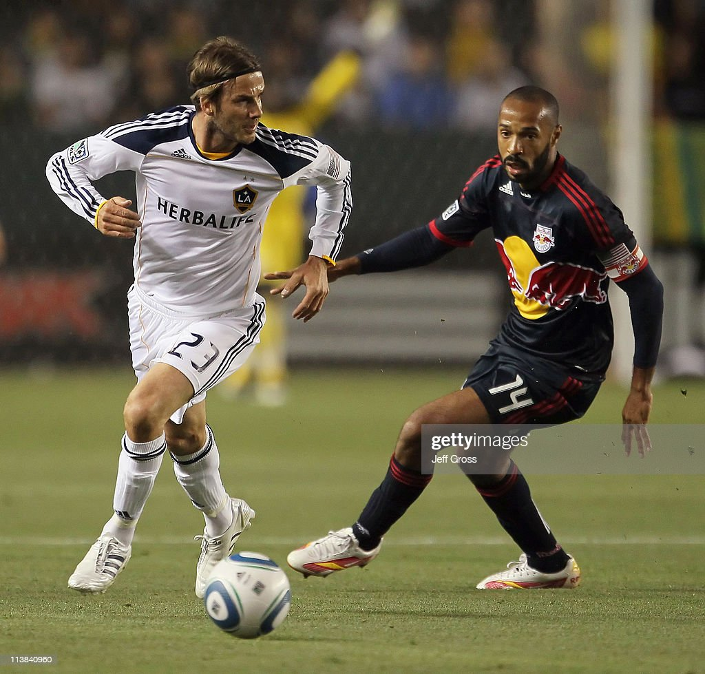 <a gi-track='captionPersonalityLinkClicked' href=/galleries/search?phrase=David+Beckham&family=editorial&specificpeople=158480 ng-click='$event.stopPropagation()'>David Beckham</a> #23 of the Los Angeles Galaxy is pursued by <a gi-track='captionPersonalityLinkClicked' href=/galleries/search?phrase=Thierry+Henry&family=editorial&specificpeople=167275 ng-click='$event.stopPropagation()'>Thierry Henry</a> #14 of the New York Red Bulls in the first half at The Home Depot Center on May 7, 2011 in Carson, California. The Red Bulls and Galaxy played to a 1-1 draw.
