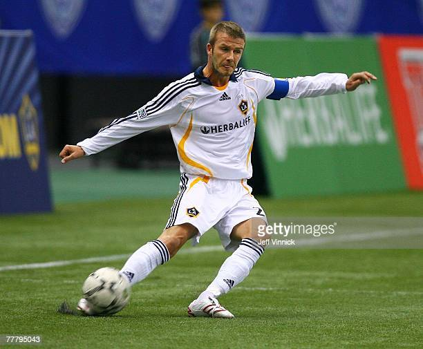 David Beckham of the Los Angeles Galaxy kicks the ball during their exhibition soccer match against the Vancouver Whitecaps at BC Place Stadium on...