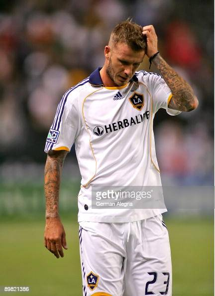 David Beckham of the Los Angeles Galaxy leaves the pitch after receiving a red card during for a serious foul against Peter Vagenas of the Seattle...