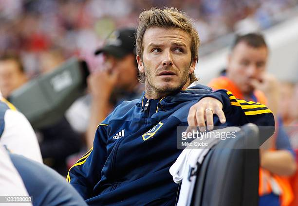 David Beckham of the Los Angeles Galaxy looks on from the bench during their match against the New York Red Bulls on August 14 2010 at Red Bull Arena...