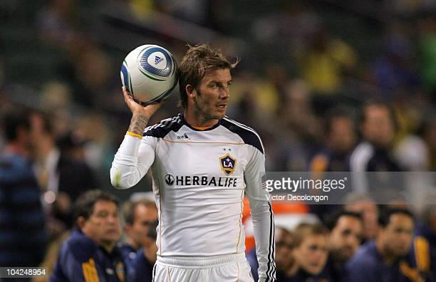 David Beckham of the Los Angeles Galaxy looks to throw the ball into play during their MLS match against the Columbus Crew at The Home Depot Center...