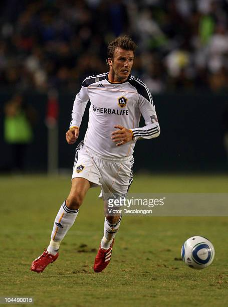 David Beckham of the Los Angeles Galaxy paces the ball on the attack during the MLS match against New York Red Bulls at The Home Depot Center on...