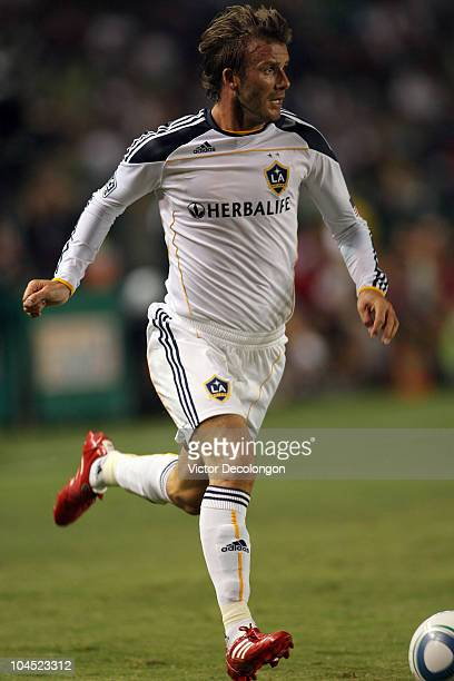David Beckham of the Los Angeles Galaxy paces the ball on the attack from the right wing during the MLS match against New York Red Bulls at The Home...
