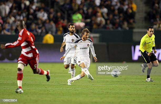 David Beckham of the Los Angeles Galaxy passes the ball on the counterattack in the second half during the Western Conference Finals match of the MLS...