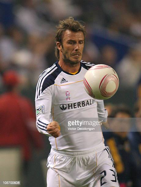 David Beckham of the Los Angeles Galaxy plays the ball off his chest in the first half during the MLS match at The Home Depot Center on October 16...