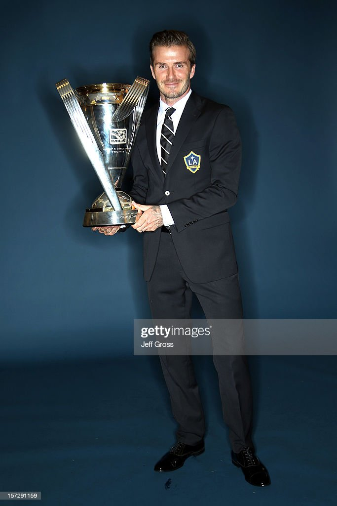 David Beckham of the Los Angeles Galaxy poses after winning the 2012 MLS Cup 3-1 against the Houston Dynamo at The Home Depot Center on December 1, 2012 in Carson, California.