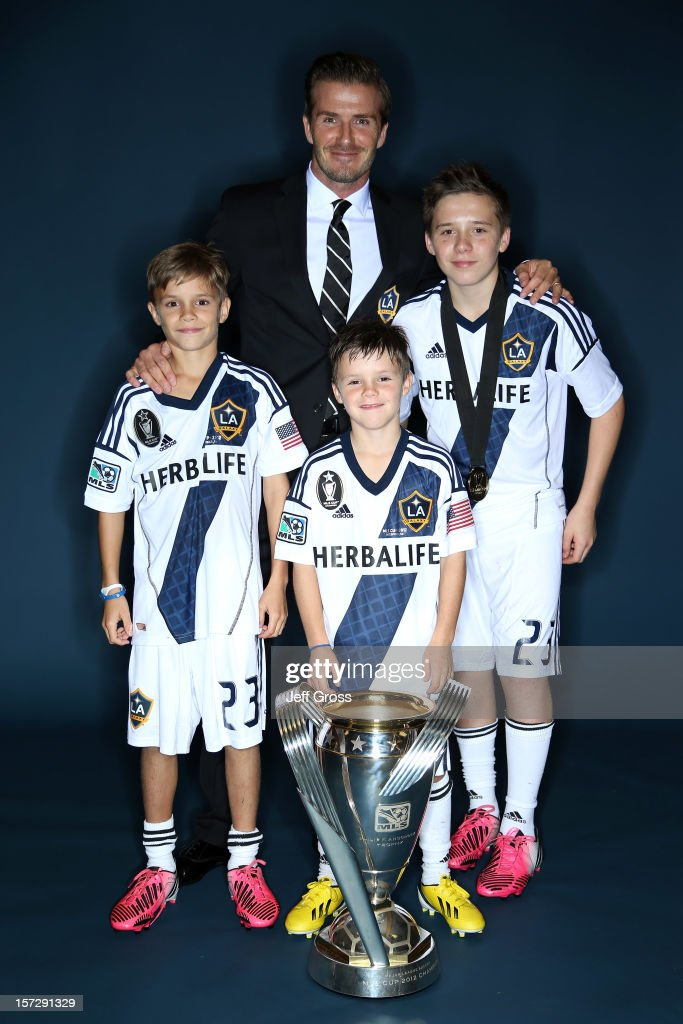 <a gi-track='captionPersonalityLinkClicked' href=/galleries/search?phrase=David+Beckham&family=editorial&specificpeople=158480 ng-click='$event.stopPropagation()'>David Beckham</a> of the Los Angeles Galaxy poses with his sons, left to right, Romeo, Cruz and Brooklyn after the Los Angeles Galaxy won the 2012 MLS Cup 3-1 against the Houston Dynamo at The Home Depot Center on December 1, 2012 in Carson, California.
