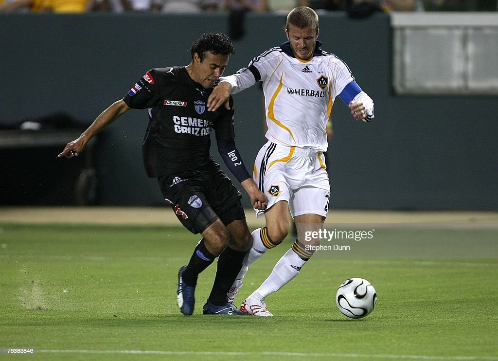 David Beckham of the Los Angeles Galaxy races for the all with Leobardo Lopez of Pachuca in the SuperLiga final on August 29 2007 at the Home Depot...