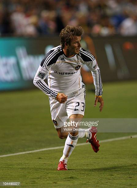 David Beckham of the Los Angeles Galaxy runs to receive a pass during the MLS match against New York Red Bulls at The Home Depot Center on September...