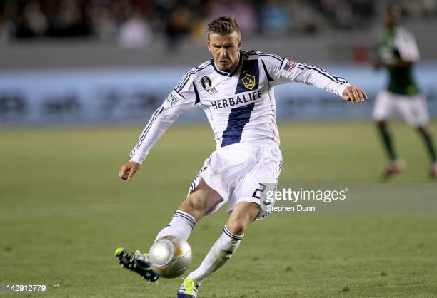 David Beckham of the Los Angeles Galaxy shoots a nd scores a goal in the second half against the Portland Timbers at The Home Depot Center on April...