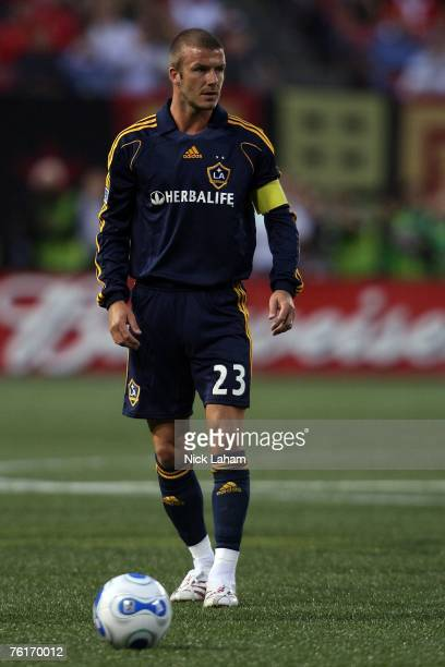 David Beckham of the Los Angeles Galaxy takes a free kick to set up Carlos Pavon for their second goal of the game against the New York Red Bulls at...