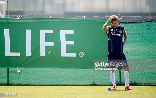 David Beckham of the Los Angeles Galaxy warms up during training session at The Home Depot Center on August 11 2010 in Carson California Beckham tore...