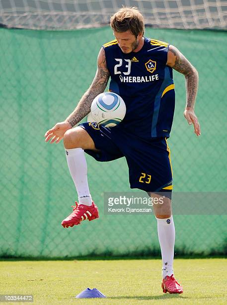 David Beckham of the Los Angeles Galaxy warms up with his teammates during a training session at The Home Depot Center on August 11 2010 in Carson...