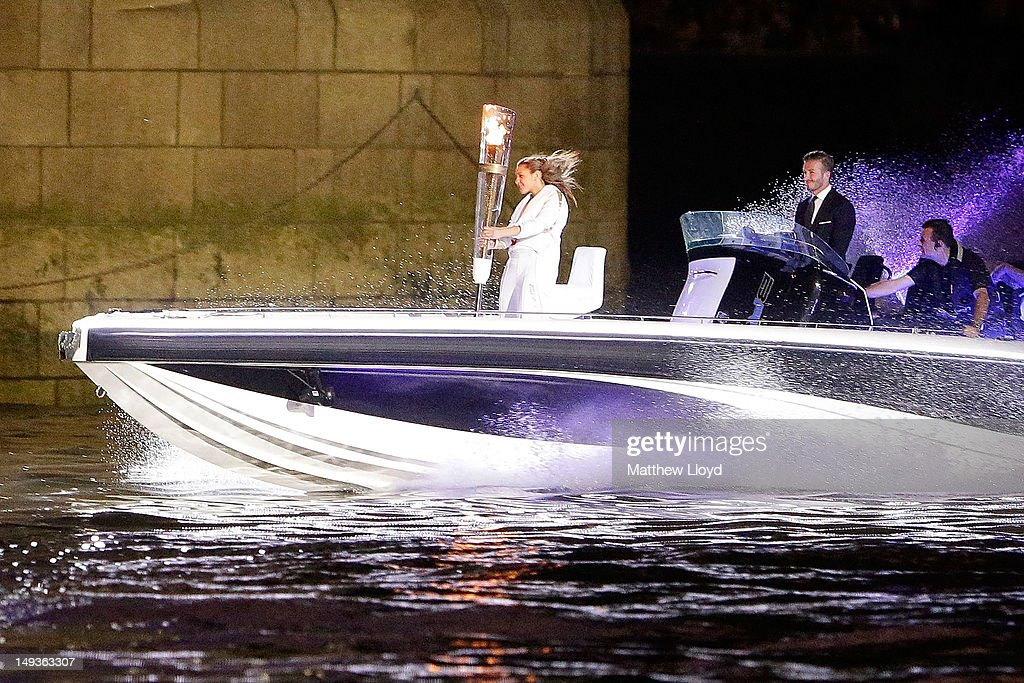 <a gi-track='captionPersonalityLinkClicked' href=/galleries/search?phrase=David+Beckham&family=editorial&specificpeople=158480 ng-click='$event.stopPropagation()'>David Beckham</a> passes under Tower Bridge driving a speedboat named 'Max Power' which carries the Olympic Torch carried by torchbearer Jade Bailey on July 27, 2012 in London, England. Athletes, heads of state and dignitaries from around the world have gathered in the Olympic Stadium for the opening ceremony of the 30th Olympiad. London plays host to the 2012 Olympic Games which will see 26 sports contested by 10,500 athletes over 17 days of competition.