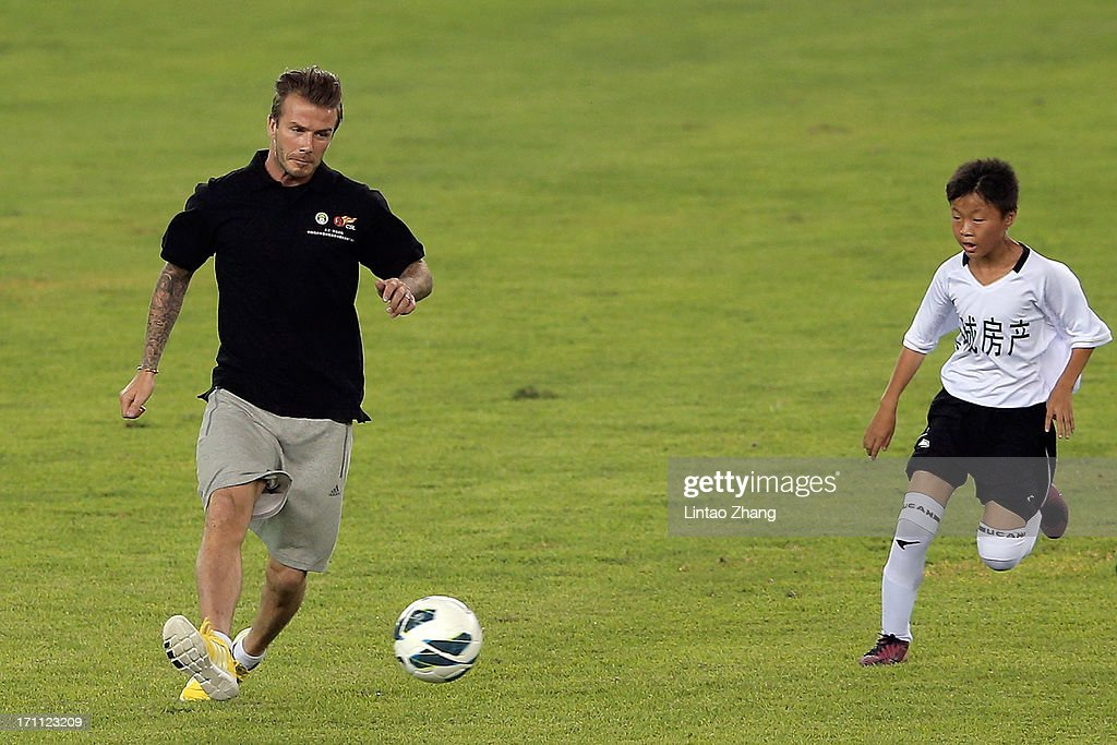 <a gi-track='captionPersonalityLinkClicked' href=/galleries/search?phrase=David+Beckham&family=editorial&specificpeople=158480 ng-click='$event.stopPropagation()'>David Beckham</a> play football with young fans during his visit Hangzhou Huanglong Stadium on June 22, 2013 in Hangzhou, China.