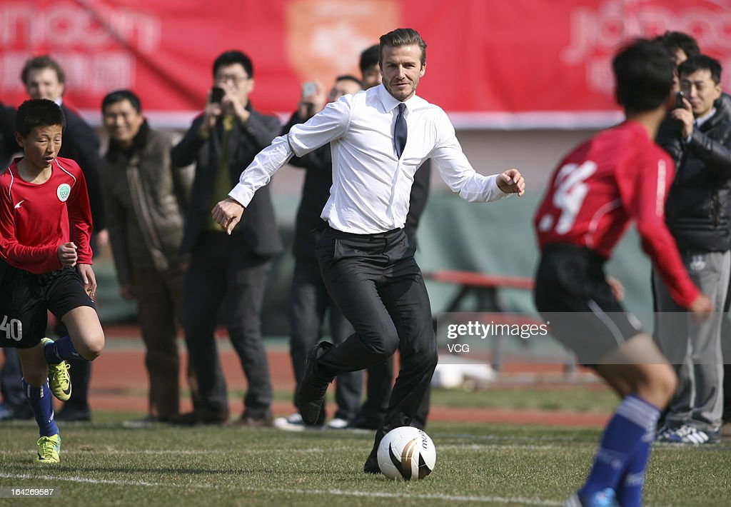<a gi-track='captionPersonalityLinkClicked' href=/galleries/search?phrase=David+Beckham&family=editorial&specificpeople=158480 ng-click='$event.stopPropagation()'>David Beckham</a> plays football with the Qingdao youth team at Tiantai Stadium on March 22, 2013 in Qingdao, Shandong Province of China.