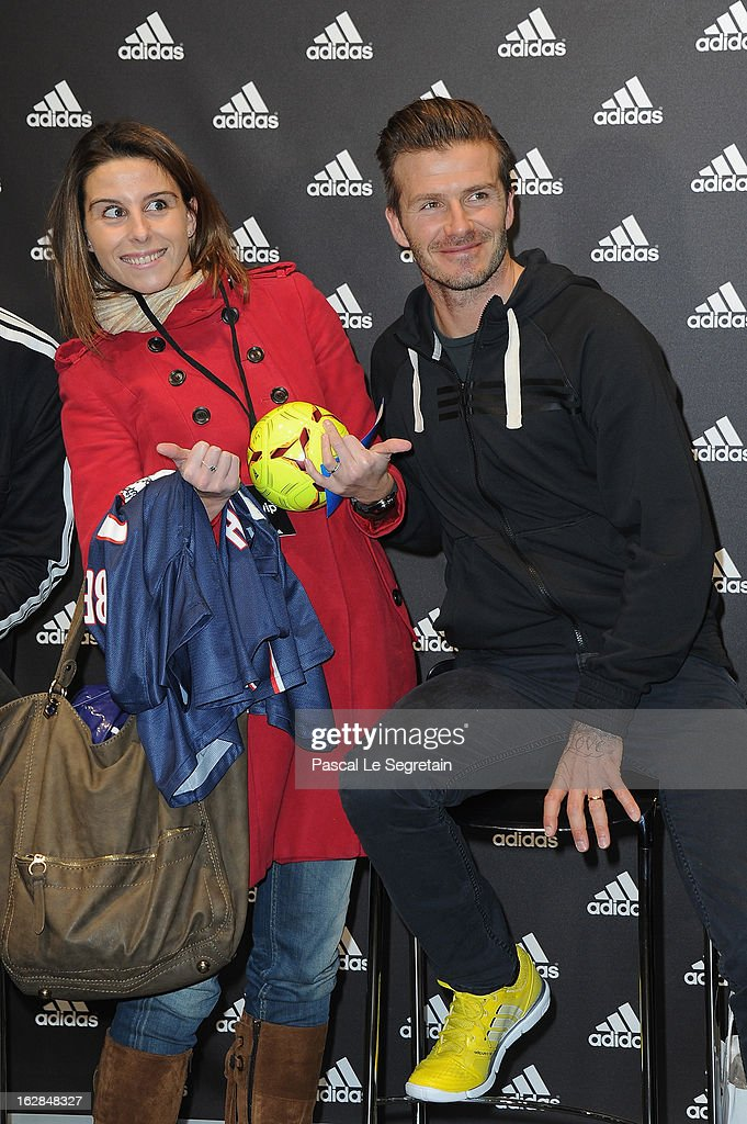 David Beckham (R) poses with a fan as he attends an autograph session at adidas Performance Store Champs-Elysees on February 28, 2013 in Paris, France.