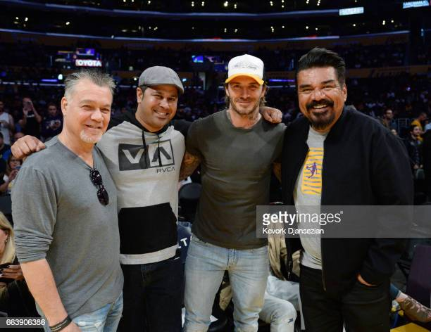 David Beckham poses with comedian George Lopez and musician Eddie Van Halen during Memphis Grizzlies and Los Angeles Lakers basketball game at...