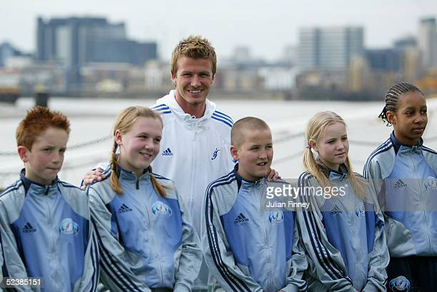 David Beckham poses with future students during the David Beckham Academy Launch Event at The Chainstore Trinity Bouy Wharf on March 14 2005 in London
