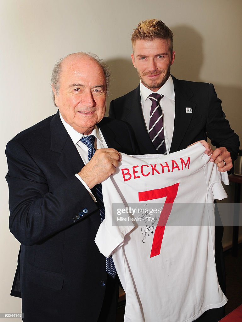 <a gi-track='captionPersonalityLinkClicked' href=/galleries/search?phrase=David+Beckham&family=editorial&specificpeople=158480 ng-click='$event.stopPropagation()'>David Beckham</a> presents FIFA President Joseph S. Blatter with a signed England shirt for Selena, President Blatter's grand daughter, at the Cape Town International Convention Centre on December 2, 2009 in Cape Town, South Africa.