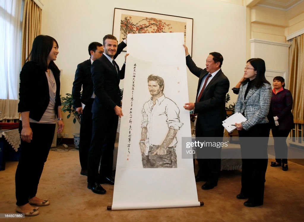 David Beckham receives a portrait of himself as he visits the Former Residence of Soong Ching Ling, the wife of Chinese revolutionary Sun Yat-sen, on March 24, 2013 in Beijing, China.