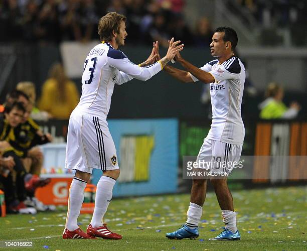 David Beckham replaces teammate Juninho upon his return to the LA Galaxy side from injury against the Columbus Crew at the Home Depot Stadium in...
