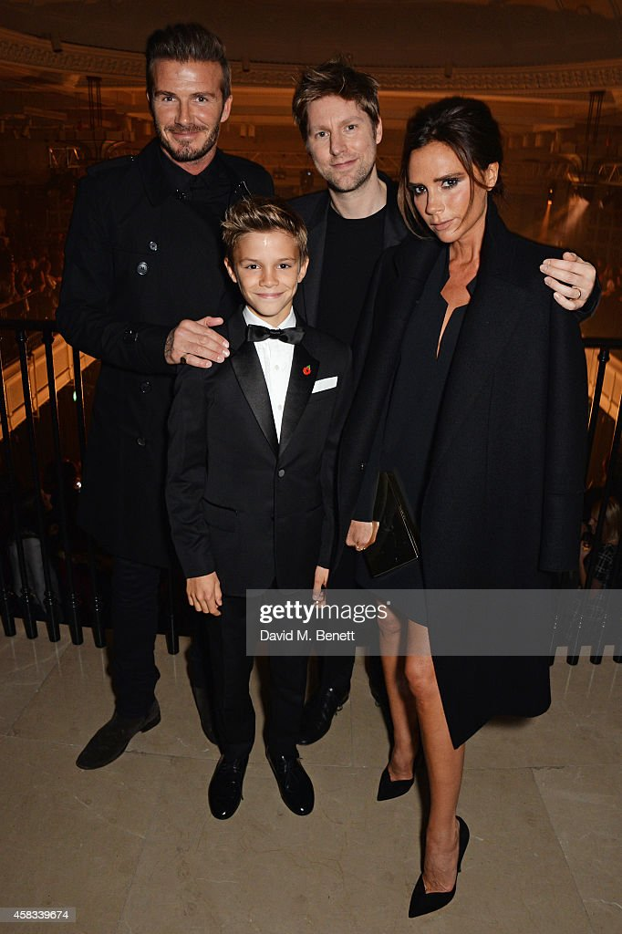David Beckham, Romeo Beckham, Christopher Bailey, Chief Creative and Chief Executive Officer of Burberry, and Victoria Beckham attend the launch of the Burberry festive campaign at 121 Regent Street on November 3, 2014 in London, England.