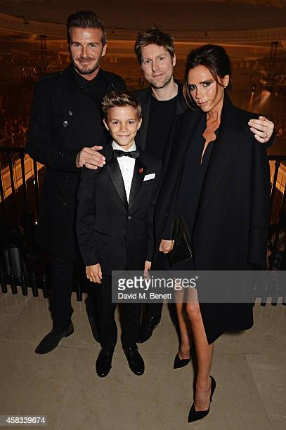 David Beckham Romeo Beckham Christopher Bailey Chief Creative and Chief Executive Officer of Burberry and Victoria Beckham attend the launch of the...