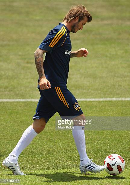 David Beckham runs the ball during an LA Galaxy training session at EnergyAustralia Stadium on November 26 2010 in Newcastle Australia